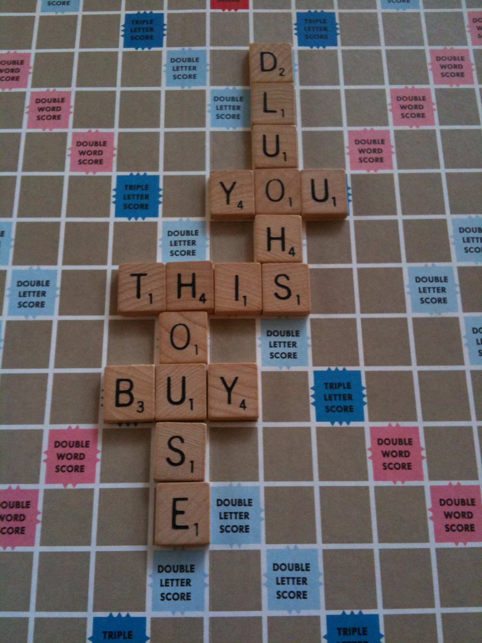 "Spelling out ""You Should Buy This House"" on a Scrabble Board"