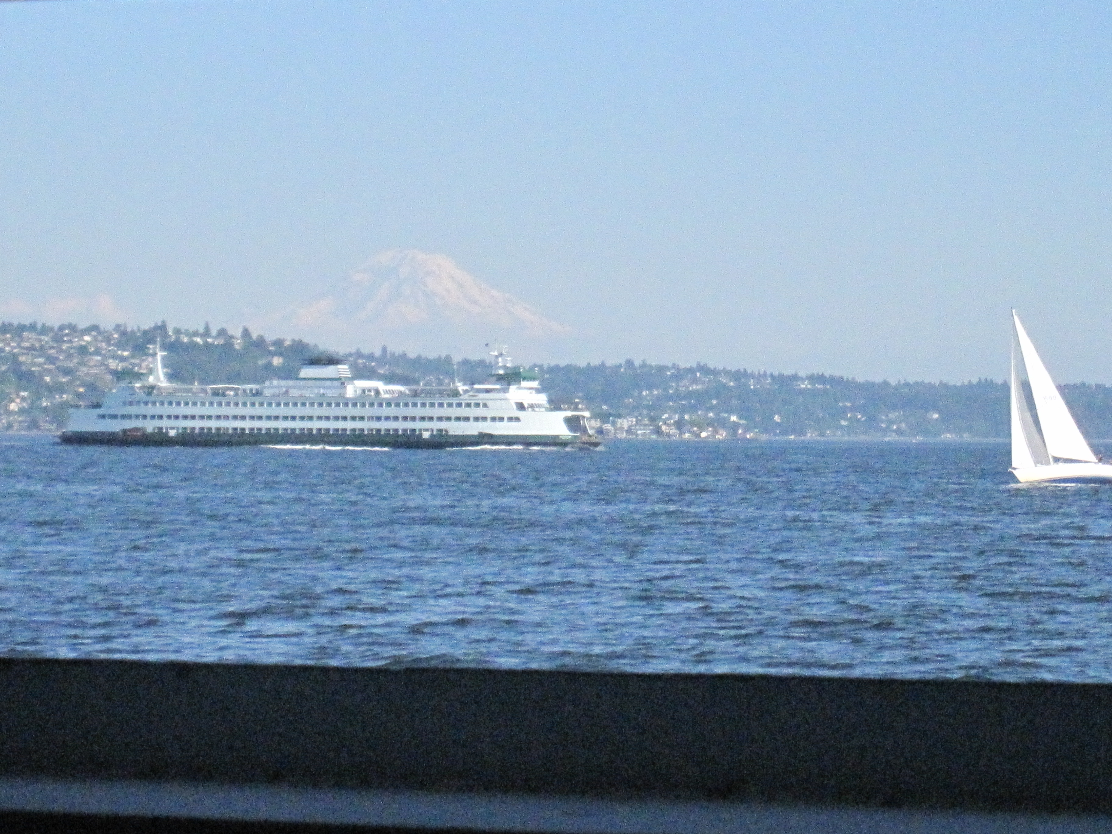 Ferries crossing Puget Sound with Mt Rainier in the background